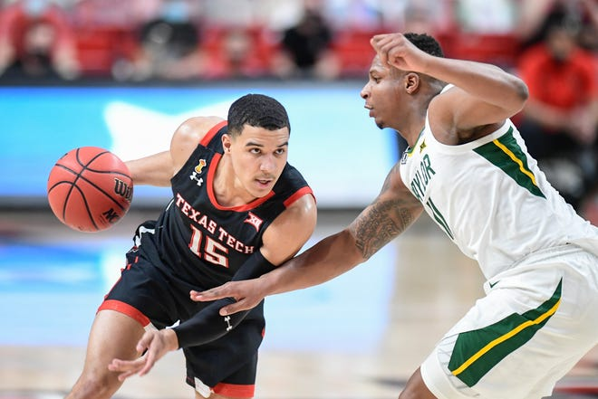 Texas Tech's Kevin McCuller (15) attempts to drive the ball around Baylor's Mark Vital (11) during the first half of a Big 12 Conference game Saturday at United Supermarkets Arena. McCullar finished with 10 points and 10 rebounds, recording his second-career double-double. [AP Photo/Justin Rex]