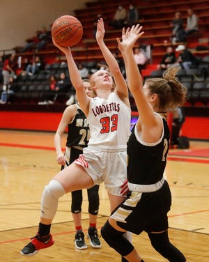 Levelland's Michaela Watkins (33) goes up for a shot defended by Big Springs's Alex Enriquez (22) in the first half of a District 3-4A game Jan 15 at Levelland High School. [Mark Rogers/For A-J Media]