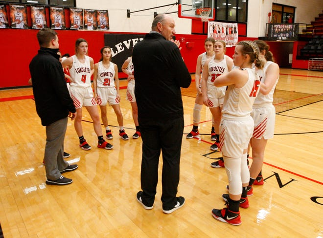 Levelland head Coach Clay Barnett talks to his players during a timeout of a District 3-4A game against Big Spring on Jan. 15 in Levelland.