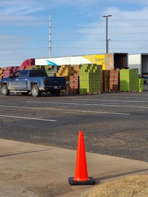 Lubbock area Girl Scouts picked up their first round of cookies during a drive-through event Saturday morning at Indiana Avenue Baptist Church.