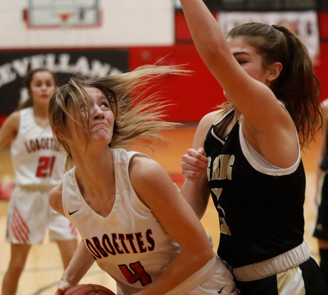 Levelland's Raegan LaBadie (4) looks to attempt a shot while being defended by Big Springs's Alex Enriquez (22) during a District 3-4A game on Jan. 15 in Levelland.