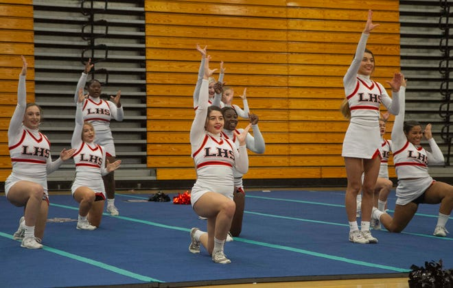 Lakeland High School cheerleaders compete in the Medium Non-Tumbling division during the Region 3 Competitive Cheer Finals at Plant City High School on Friday.