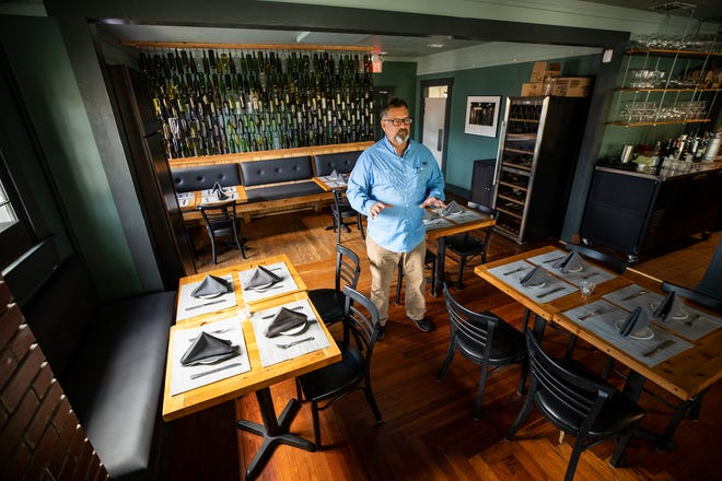 Richard DeAngelis, owner of the Red Door restaurant in Lakeland, said the danger to local small businesses from COVID-19 is far from over. He said his restaurant has barely survived, and it's not out of the woods yet.