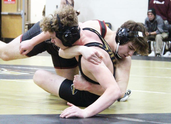 Osage's Jackson Creasy looks to take down Versailles' Preston James in the 195-pound match in a quadrangular at Versailles on January 14. Creasy won the match by pin fall.