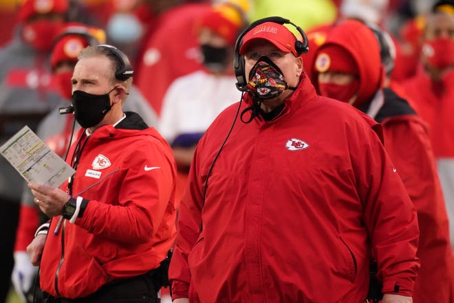 Kansas City Chiefs head coach Andy Reid, right, watches from the sideline during the first half of an NFL football game against the Los Angeles Chargers, Sunday, Jan. 3, 2021, in Kansas City.