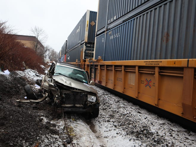 A man was hospitalized after his vehicle collided with a freight train Friday, Jan. 16. 2021 on his way to Scooby Rendering in Whitestown, police said.