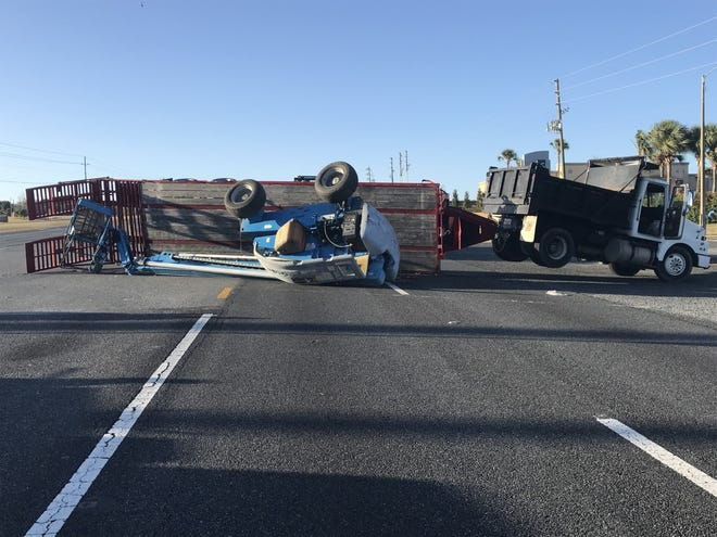 A dump truck towing a crane crashed in Summerfield on U.S. 441, blocking northbound traffic on Saturday afternoon.