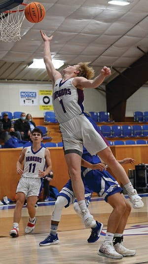 Mountainburg's Ethan Gregory goes up for the shot against Paris at home on Dec. 3, 2020. The Dragons (13-3, 5-1) picked up a conference win on Friday, Jan. 15, 2021, as Gregory led his team with 18 points. He's the Times Record Athlete of the Week.