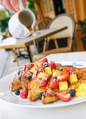 """Pain perdu,"" or French toast, is served with seasonal fruit and agave syrup during weekend brunch at La Goulue."