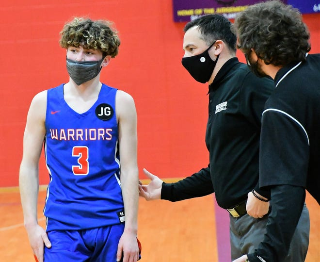 Winnacunnet coach Jay McKenna, right, makes a point to senior guard Braiden Burns during Friday's game in Rochester. Burns played at Spaulding High School two years ago as a sophomore. He spent last year in Arizona, but returned to N.H. this past year to attend Winnacunnet.