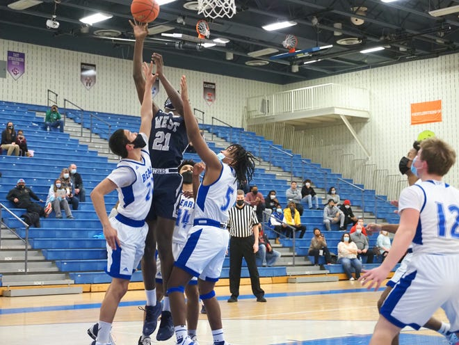 Pocono Mountain West's Christian Fermin goes up for a shot surrounded by Pleasant Valley's Leland Hargrow, Joel Contreras and Jarod Moore on Friday, January 15, 2021. Pocono Mountain West won the game, 53-40.