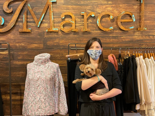 Dixie Carroll, owner of Providence clothing boutique J Marcel, with her dog Piper. Her store has moved to online sales and curbside pickup only.