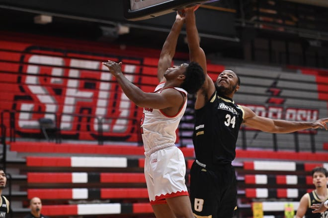 Bryant's Hall Elisias, seen here on Thursday, led the way on Friday with 20 rebounds and three blocks in the Bulldogs' 72-63 victory over Saint Francis.