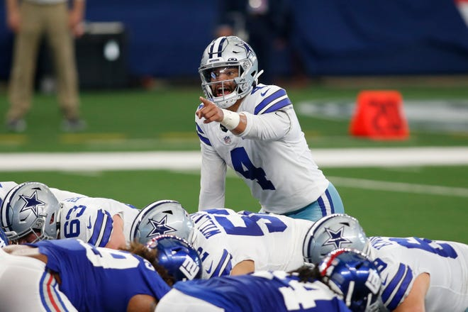 Cowboys quarterback Dak Prescott calls a play during the game in October against the New York Giants at AT&T Stadium in Dallas. Prescott suffered a season-ending injury in the third quarter of this game.