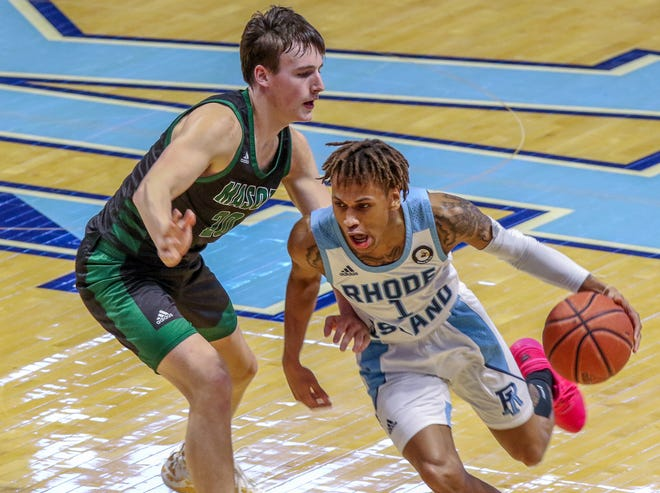 URI's Fatts Russell, who led the Rams with 18 points, drives to the net past George Mason's Tyler Kolek, the former St. Andrew's star, during Saturday's Atlantic 10 game in South Kingstown.