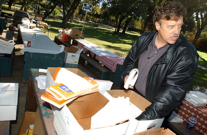 Don Parsons sorts materials for a bond issue Sept. 13, 2002, at Stockton's Victory Park.