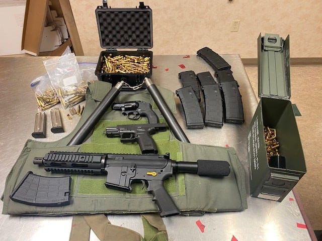 A cache of multiple illegally possessed firearms, ammunition, body armor, and jewelry taken in a robbery were discovered during a search in Lodi.