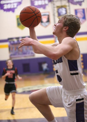 Jackson's Ben Sullivan goes to the basket during a game against Hoover in January.