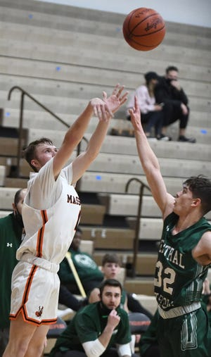 Massillon's Grant Haynam, shown shooting the ball during Friday's win over Central Catholic, hit the game-tying 3-point basket late in regulation on Sunday in the Tigers' overtime win over Boardman in the Spectrum Orthopaedics Classic at Hoover High School.  (IndeOnline.com / Kevin Whitlock)