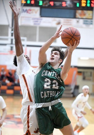 Jude Boron of Central Catholic drives to the basket with defense from Ardell Banks of Massillon in the second half.
