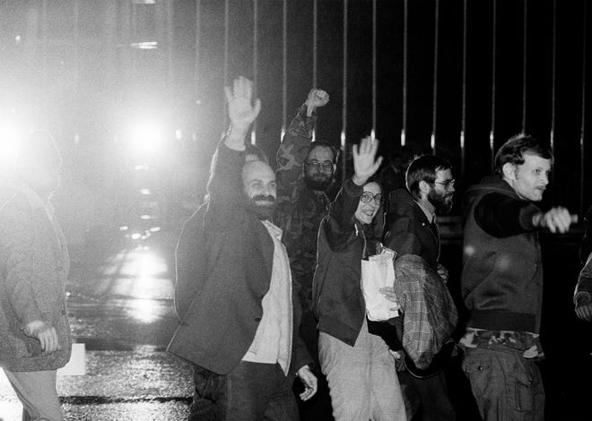 American hostages wave to newsmen as they arrive at Algiers airport from Tehran on Jan. 21, 1981. From left are Barry Rosen, Donald Cooke, Kathryn Koob and and two unidentified men. Today is the 40th anniversary of the release of 52 American hostages who were held by Iran for 444 days.