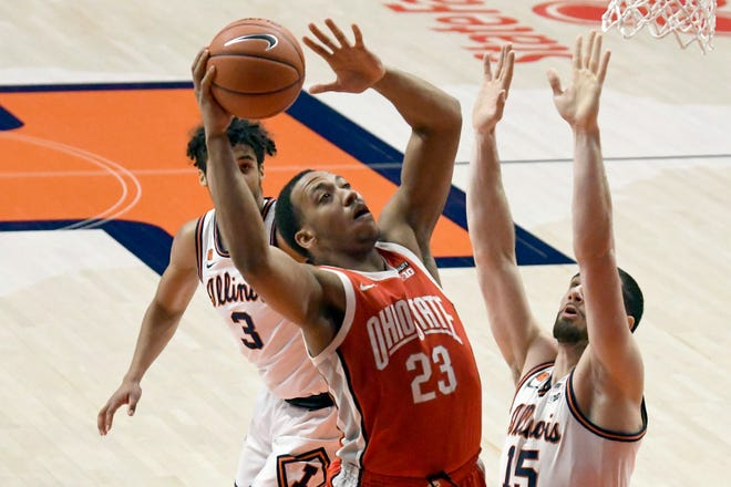 Ohio State's center Zed Key puts up a shot over Illinois forward Giorgi Bezhanishvili during the first half Saturday in Champaign. (AP Photo/Holly Hart)