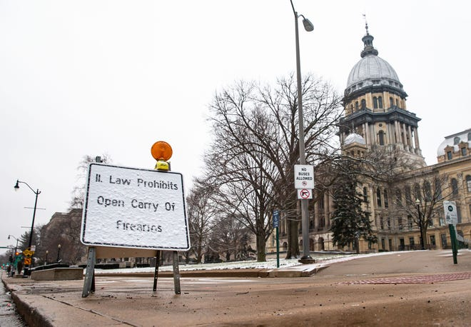 Signs stating that Illinois law prohibits open carry of firearms have been placed around the Illinois State Capitol in preparations for possible protests, Saturday, January 16, 2021, in Springfield, Ill. Illinois Gov. JB Pritzker announced that he has activated 250 members of the Illinois National Guard amid threats of armed protests in capital cities across the country in the days leading up to President-elect Joe Biden's inauguration. [Justin L. Fowler/The State Journal-Register]