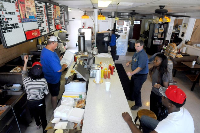 Parchies owner Dave Wishon serves customers in the file photo. Since opening in 1984, his has become one of the city's most diverse dining rooms, with all walks of life lining up for his steak and cheese sandwiches and barbecue plates.            [FILE PHOTO/STARNEWS]