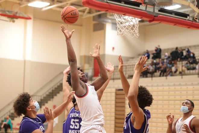 Highland Park senior CJ Powell scores another two late in the second half against Topeka West Friday at Highland Park high school. The Scots won 57-54 in overtime.