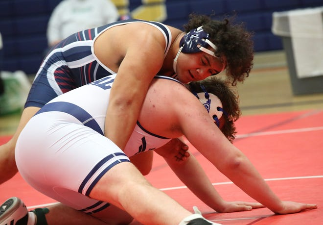 Manhattan's Damian Ilalio (top) was named outstanding wrestler of the Centennial League meet on Saturday, beating Washburn Rural's David Huckstep 5-3 in the 285-pound title match.