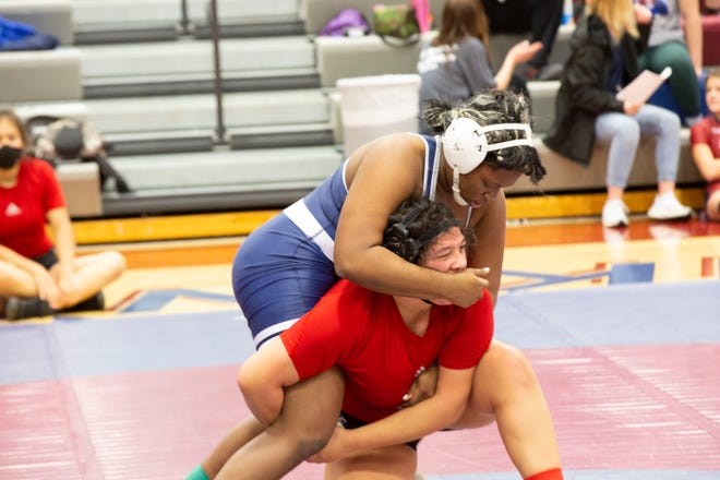 Washburn Rural's Dajia Anderson tries to get a grip on Emporia's Trinity Ervin during the first of their 191-pound matches at Friday's Centennial League meet at Seaman. Ervin won that match 9-2 but Anderson came back to pin Ervin in their second meeting with Ervin suffering an injury that forced her to forfeit a third match. Anderson was one of five champions for Rural, which won the team title by five points over Emporia.