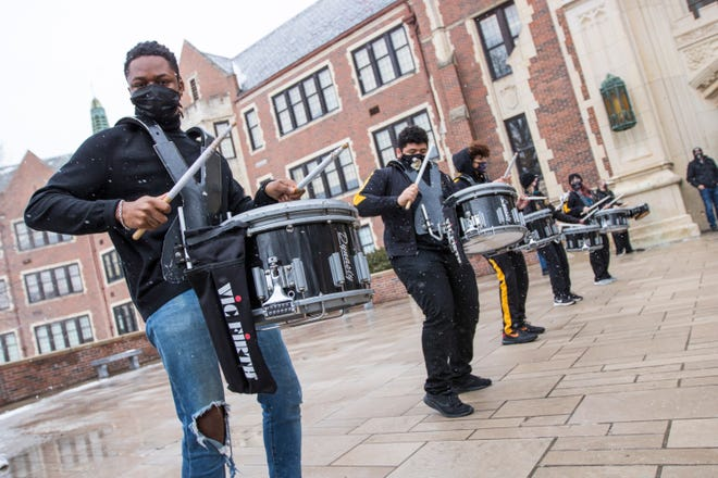 Members of the Topeka High School Trojans drumline play pep songs as students leave the building for the last time before heading back to remote learning for a third time this school year. District officials have indicated students could return to in-person learning once the district returns to lower percentages of staff out because of COVID-19 isolations or quarantines, but they also warned it could be spring break before that happens.