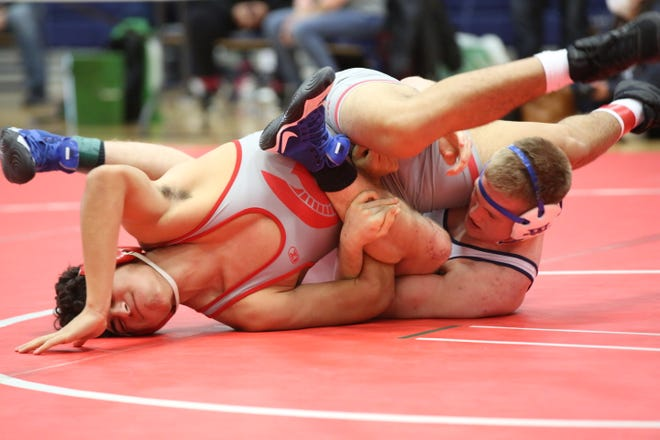 Washburn Rural's Remington Stiles, right, works Emporia's Bobby Trujillo to his back during their 182-pound match at Saturday's Centennial League meet. Stiles won 7-3 to take his second straight league title and help the Junior Blues to a repeat championship.