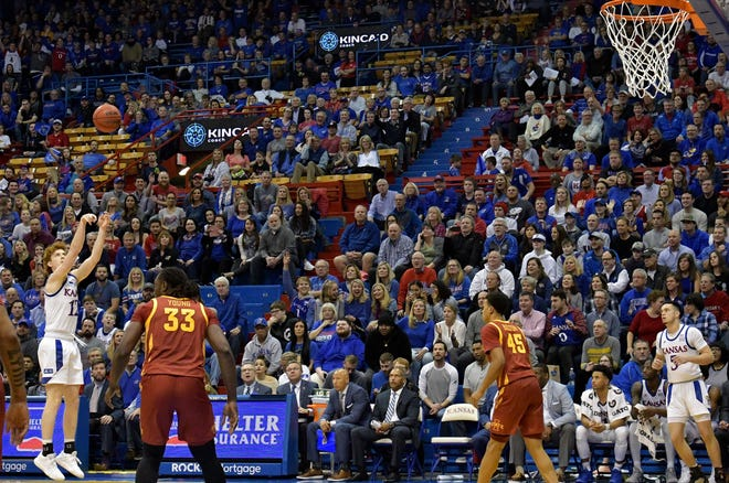 Kansas basketball's Chris Teahan attempts a 3-pointer as Iowa State's Solomon Young (33) looks on during a matchup on Feb. 17, 2020, in Lawrence. The Jayhawks and Cyclones were scheduled to meet at 1 p.m. Saturday in Allen Fieldhouse, but that game has been postponed due to COVID-19 protocols within ISU's program.