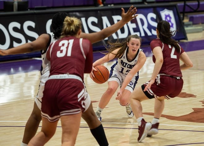 Holy Cross' Cara McCormack works around the Colgate defense during Saturday's game at the Hart Center.