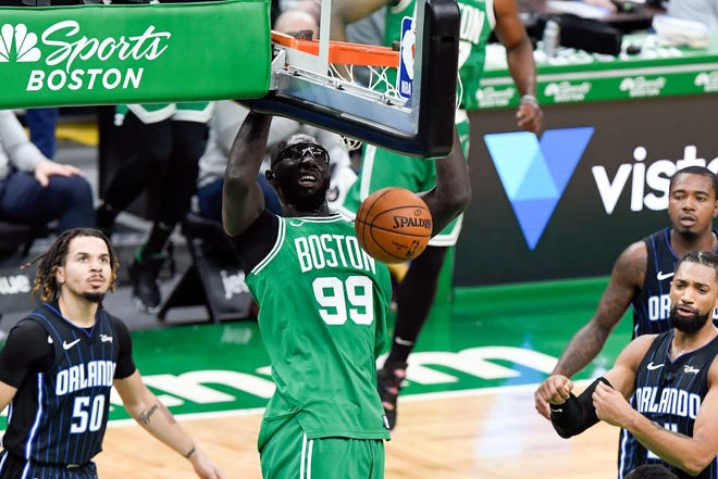 Celtics center Tacko Fall (99) dunks and scores against the Magic during the fourth quarter at TD Garden.