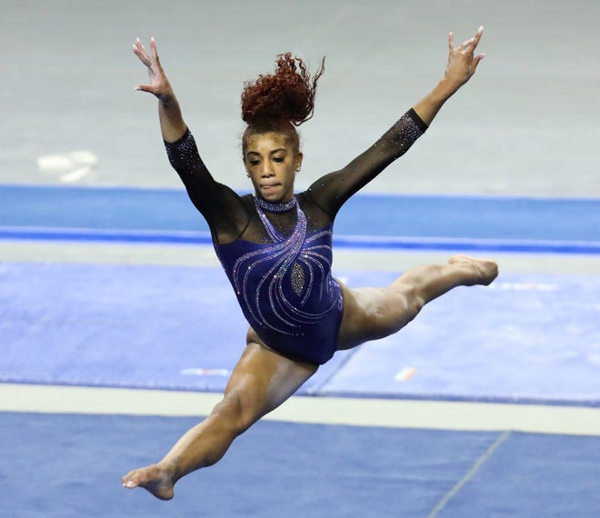 Florida gymnast Nya Reed performs on the floor Friday against Georgia at Exactech Arena. The Gators beat the Bulldogs 197.250 to 196.075.