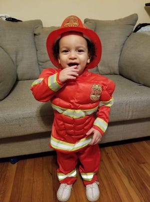 Levi Moore dressed as a firefighter for Halloween one year.