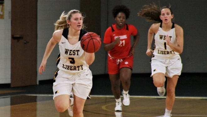 Dover graduate Olivia Belknap heads downcourt for West Liberty on Saturday.