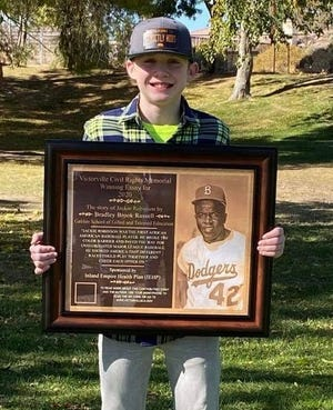Galileo School student Bradley Brook Russell's winning essay inspired the Jackie Robinson plaque, which honors the Brooklyn Dodgers legend who broke major league baseball's color barrier.
