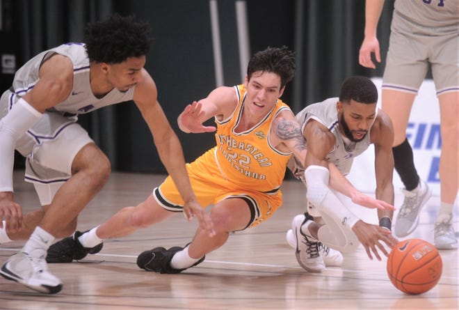 ACU's Reggie Miller, right, and Coryon Mason fight Southeastern Louisiana's Nick Caldwell for a loose ball. ACU beat the Lions 76-42 in the Southland Conference game Jan. 16 at the Teague Center.