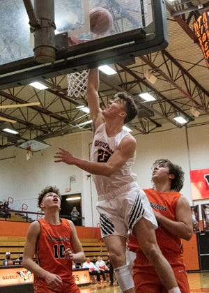 Waverly's Phoenix Wolf takes it to the rim Friday night at Waverly High School. Waverly fell to Portsmouth West 58-57.