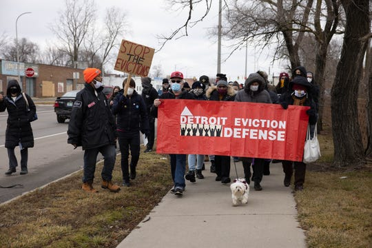 Members of the Detroit Eviction Defense and Detroit Will Breathe march to the 10th Precinct Police Department in Detroit on January 16, 2021.