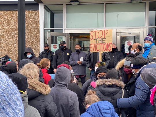 Protesters gather in front of the Detroit Police Department's 10th Precinct on the city's northwest side on Saturday urging police to stop assisting evictions. Detroit Police Cmdr. Tiffany Stewart addresses the crowd.