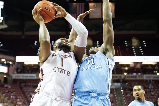 Seminoles forward RaiQuan Gray (1) attempts a contested close-range shot vs. the North Carolina Tar Heels at the Donald L. Tucker Civic Center in Tallahassee, FL., on Jan. 16, 2020.
