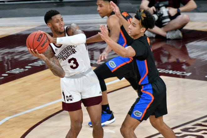 Mississippi State guard D.J. Stewart Jr. (3) handles the ball while defended by Florida guard Tre Mann (1) during the first half Saturday at Humphrey Coliseum in Starkville.