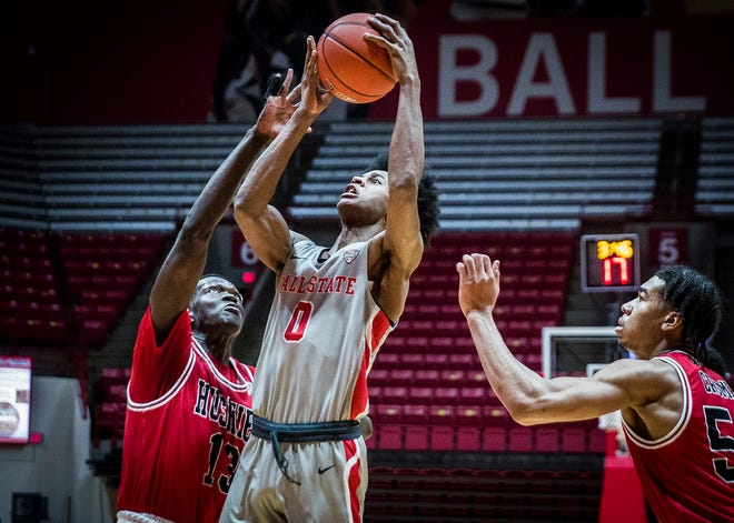 Ball State's Miryne Thomas shoots past Northern Illinois' defense during their game at Worthen Arena Saturday, Jan. 16, 2021.