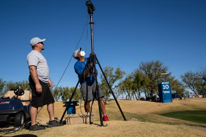 Anthony Rodriguez, left, and Cedric Baldwin of PGA Tour ShotLink gather course data for upcoming live television coverage of The American Express at the PGA West Stadium Course in La Quinta, Calif., on January 16, 2021.