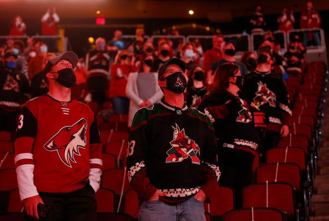Coyotes fans await the game before the first period against the Sharks at Gila River Arena.