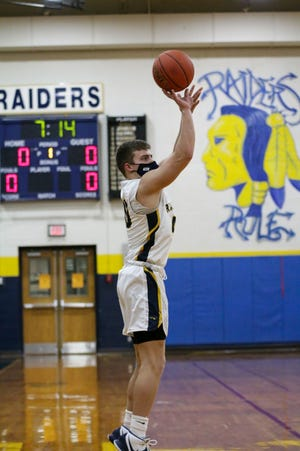Elco's Braden Bohannon puts up a 3 point shot early in the 1st quarter vs Donegal.